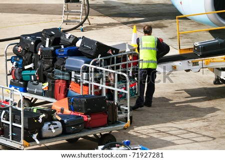 Many suitcases. Luggage when loaded on an airplane. Luggage and travel bags. - stock photo