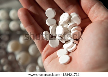 many tablets in hand - stock photo