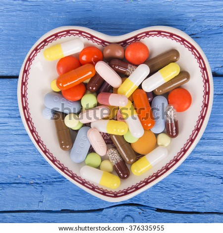 Many tablets on a plate - stock photo