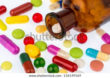 many tablets with a glasbegh���¤ter. photo icon for addiction and costs in medicine and medicines. - stock photo