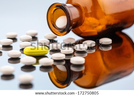 many tablets with a glasbegh?ter. symbolic photo for addiction and costs in medicine and medicines. - stock photo