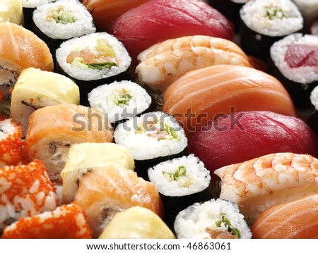 many tasty fresh japanese sushi with tuna, caviar and shrimp