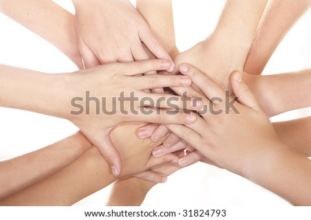 Many team hands in the huddle white background - stock photo