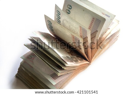 Many Thai Baht currency on isolated white background