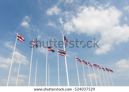 Many Thailand flag with blue sky and cloud in background.