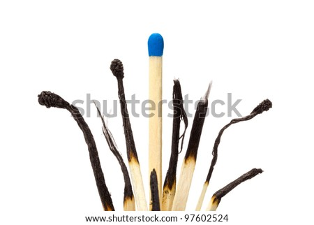 Many the spoiled matches on a white isolated background. One match the whole. - stock photo