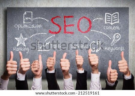 many thumbs up to search engine optimization plan - stock photo