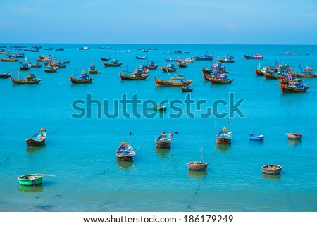 Many traditional boats in fishing village, Vietnam, Southeast Asia - stock photo