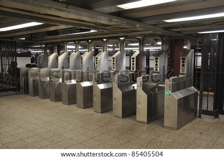 Many turnstile in Manhattan subway station - stock photo