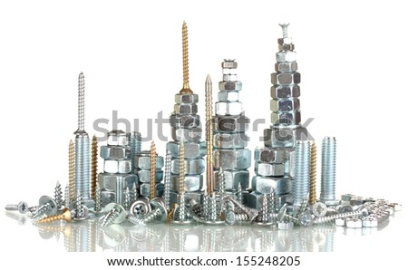 Many types of metal bolts, screws and nuts isolated on white  - stock photo
