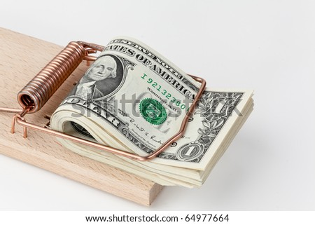 Many U.S. dollar banknotes in mouse trap - stock photo