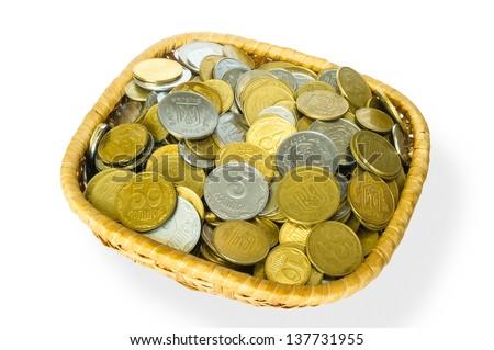 Many ukrainian kopek in a little basket - stock photo