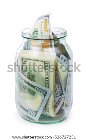 Many 100 US dollars bank notes in a glass jar isolated on white background