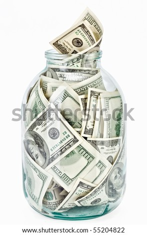 Many 100 US dollars bank notes in a glass jar isolated  on white background - stock photo