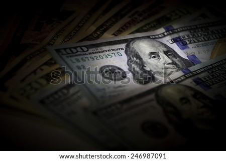 Many US dollars banknotes as background. Photos in the low key - stock photo