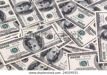 Many USD banknotes as a wallpaper - stock photo