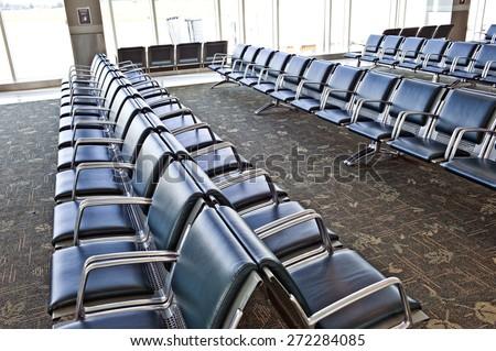 Many Vacant Seats Inside Airport - stock photo