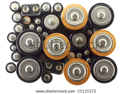 Many various batteries on the white background