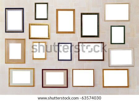 Many various blank frameworks for photos hang on a wall. With clipping patch. - stock photo