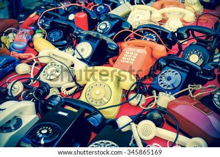 Many vintage phones retro style photo - stock photo