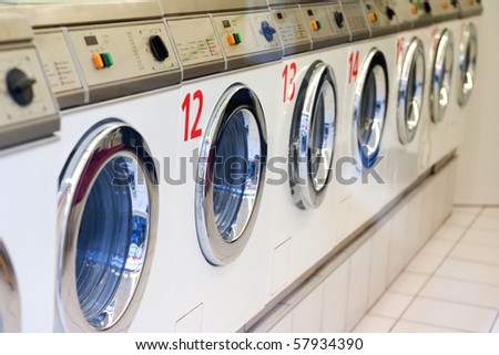 Many washing machines in a row for the laundry - stock photo