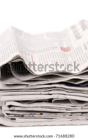 Many wastepaper of newspapers fold in stack on white background in vertical orientation, nobody.