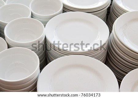 Many  white different plates stacked together