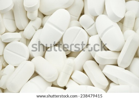 many white drugs pills shapes texture background - stock photo