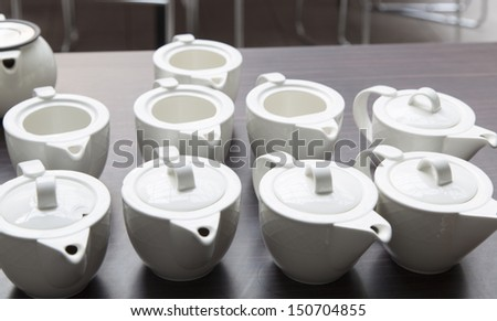 many white porcelain teapot on the table - stock photo