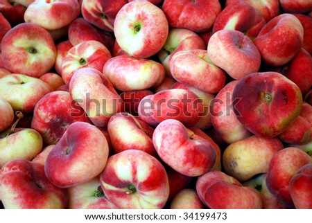 many wild peaches on a market stall
