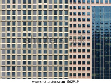 Many windows on tall buildings. - stock photo