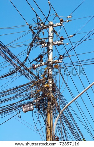 Many wires on an electric pillar in Hanoi, Vietnam - stock photo