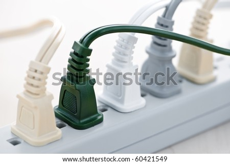 Many wires plugged into electric power bar - stock photo