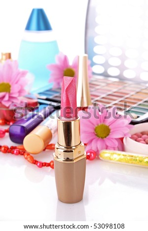 Many   woman cosmetics with flower   on white white background - stock photo