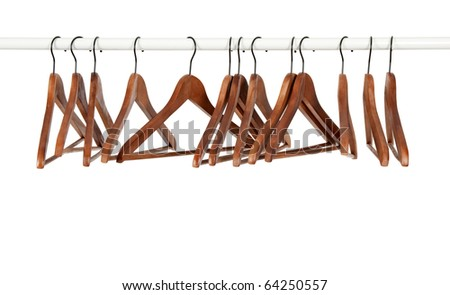 Many wooden hangers on a rod, isolated on white background. - stock photo