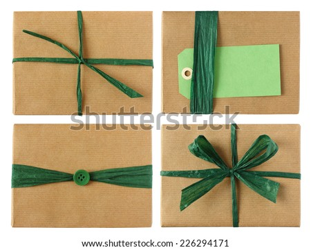 Many wrapped presents with blank gift tag, button, ribbon & bow in green color theme