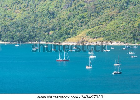 Many yachts at the bay in front of the mountain - stock photo