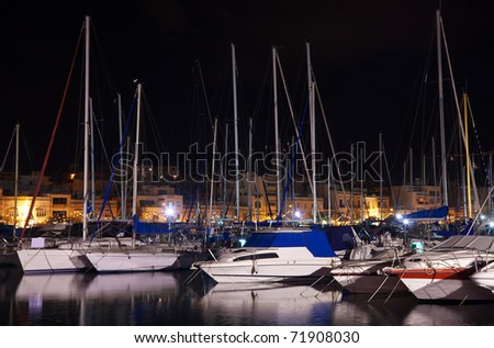 Many yachts lying at Malta harbour in  night, Valletta - stock photo