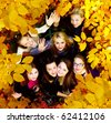 many young girls in the autumn park. View from top. - stock photo