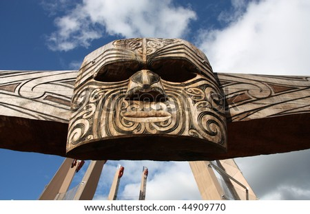 Maori carving - face mask carved in the wood. Rotorua, New Zealand. - stock photo