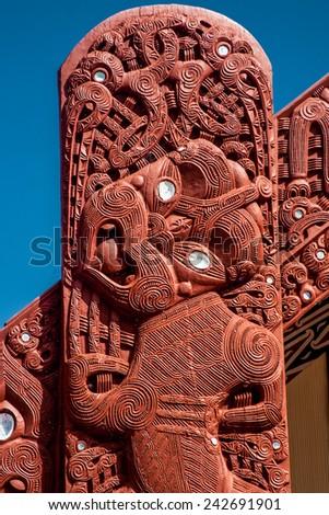 Maori traditional theme, wooden sign, New Zealand - stock photo