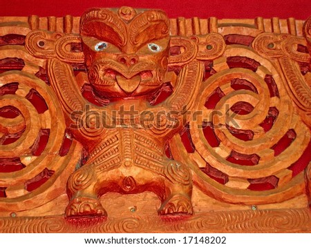 Maori Wooden carved figure of wahine(Woman) depicting fertility - stock photo