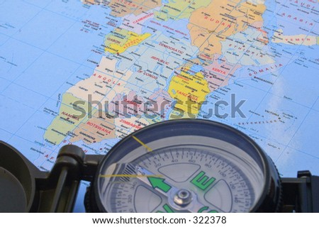 map and compass - stock photo