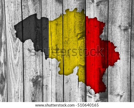 Map and flag of Belgium on weathered wood