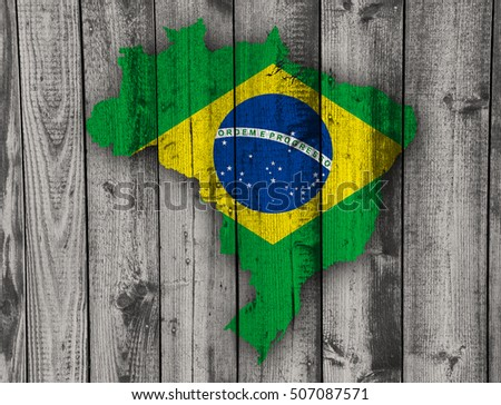 Map and flag of Brazil on weathered wood