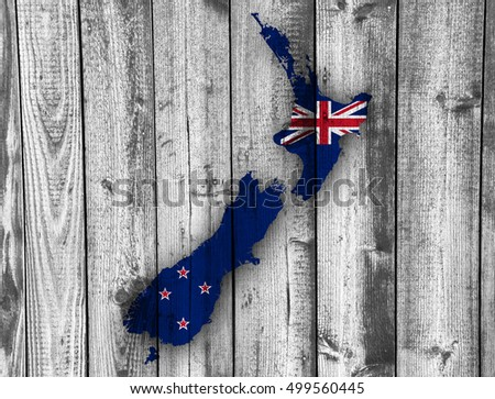 Map and flag of New Zealand on wood