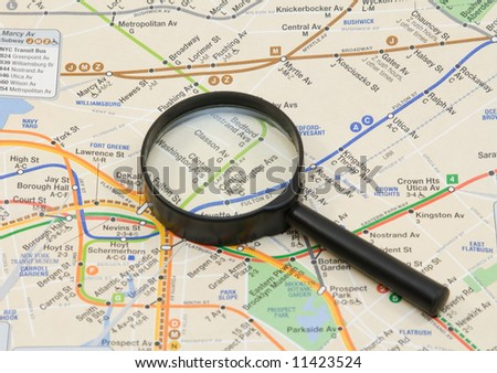 map and magnifier - stock photo