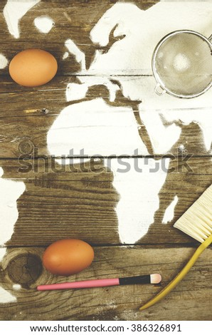 Map of Africa made of flour on old wood - stock photo