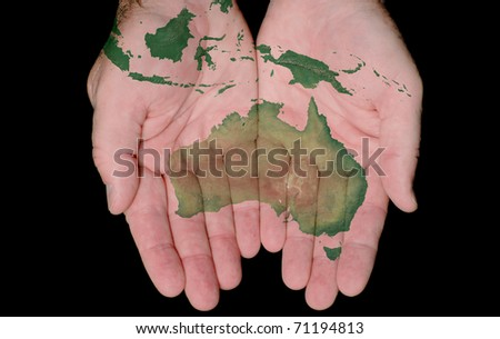 Map Of Australia Painted On Hands Showing Concept Of Australia In Our Hands