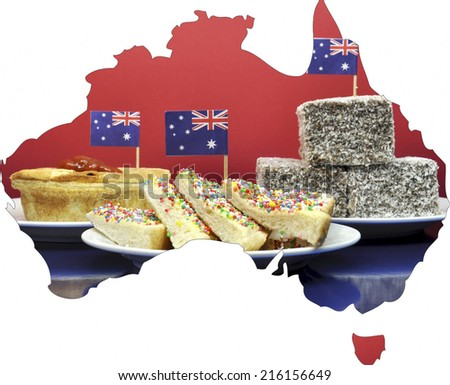 Map of Australia showing traditional Aussie tucker party food, lamingtons, fairy bread and meat pies, with toothpick Australian flags. - stock photo